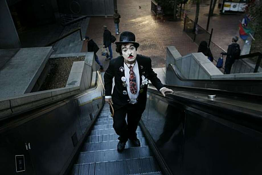 Not long after the sun winked above the morning fog, Robert Martin, dressed as Charlie Chaplin, heads to his job as the host of Lori's Diner in San Francisco. Photo: Mike Kepka, The Chronicle