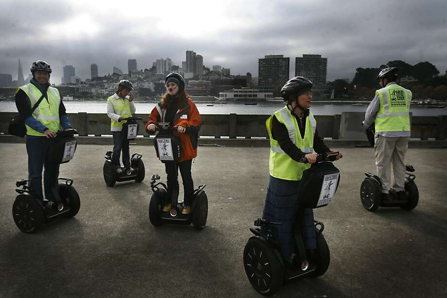 A group of tourists experience the San Francisco skyline during a two hours Segway tour of Fisherman's Wharf.   MANDATORY CREDIT FOR PHOTOG AND SAN FRANCISCO CHRONICLE/NO SALES-MAGS OUT Photo: Mike Kepka, The Chronicle