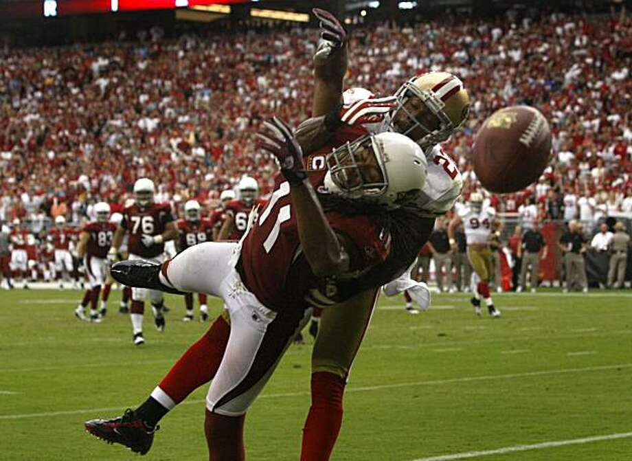 Nate Clements (22) breaks up a pass in the end zone intended for Cardinals wide receiver Larry Fitzgerald (11) in the second quarter of the San Francisco 49ers vs. Arizona Cardinals NFL game in Glendale, Ariz., on Sunday, Sept. 13, 2009. Photo: Paul Chinn, The Chronicle