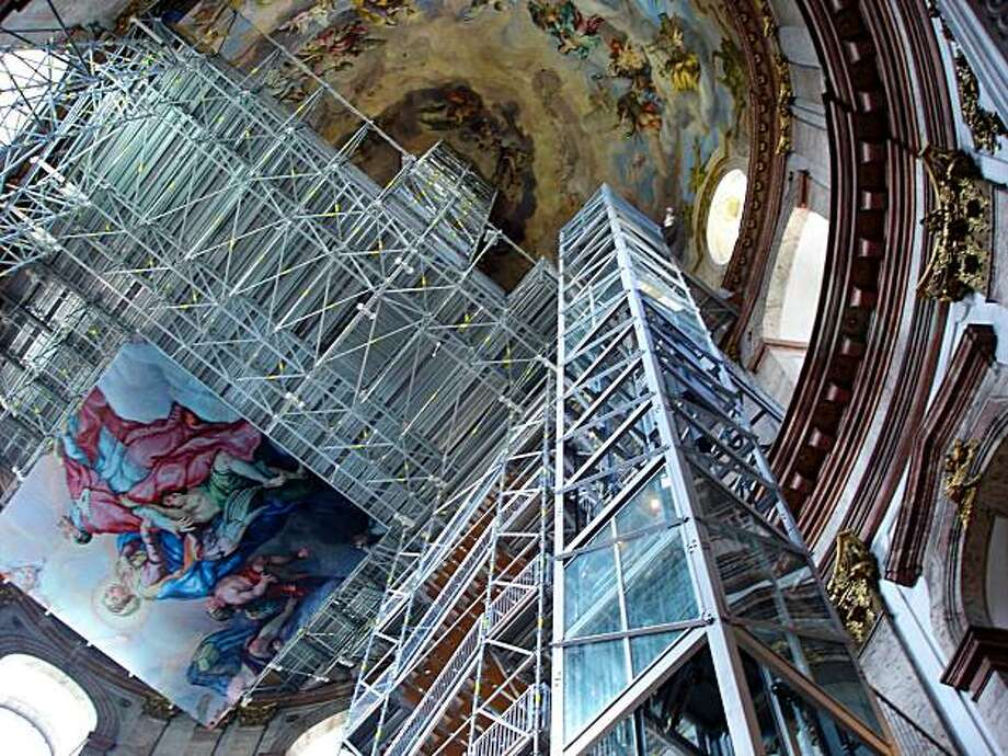 For the next couple of years, visitors can ride an elevator into the cupola of Vienna's Karlskirche for a close-up look at the dome's gold leaf, paintings, and fake marble. Photo: Rick Steves