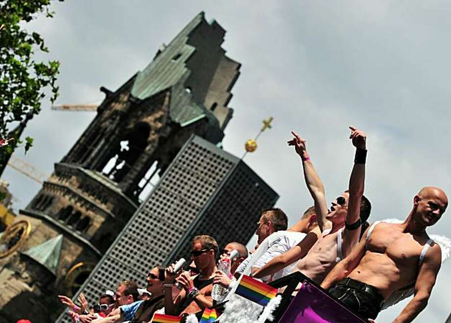 Participants of the Christopher Street Day (CSD) gay pride parade celebrate in front of Berlin's Memorial Church (Gedaechtniskirche) in Berlin on June 19, 2010. Gays and lesbians around the world celebrate the Christopher Street Day (CSD) gay and lesbianpride parade, arguably the most important date in their calendar. Photo: Johannes Eisele, AFP/Getty Images