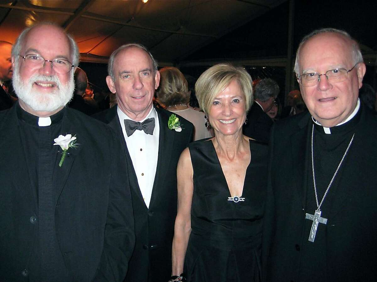 Father Gregory Boyle (left) with Craig and Maureen Sullivan and Archibishop George Niederauer at the Catholic Charities CYO Loaves & Fishes Dinner. March 2011. By Catherine Bigelow. Ran on: 03-13-2011 The Rev. Gregory Boyle (left), Craig and Maureen Sullivan and Archbishop George Niederauer.