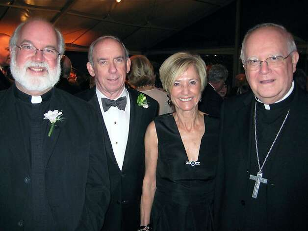 Father Gregory Boyle (left) with Craig and Maureen Sullivan and Archibishop George Niederauer at the Catholic Charities CYO Loaves & Fishes Dinner. March 2011. By Catherine Bigelow.     Ran on: 03-13-2011 The Rev. Gregory Boyle (left), Craig and Maureen Sullivan and Archbishop George Niederauer. Photo: Catherine Bigelow, Special To The Chronicle