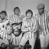 6th November 1966: American rock group The Beach Boys at the Finsbury Astoria. They are, (from left to right) Bruce Johnston, Al Jardine (front), Carl Wilson (1946 - 1998), Dennis Wilson (1944 - 1983), and Mike Love..