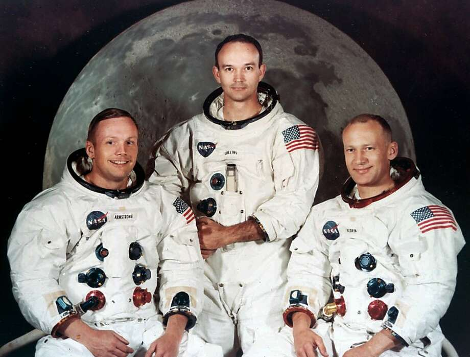 FOR USE WITH FEATURE PACKAGE FOR JULY 8---APOLLO ANNIVERSARY--FILE--Astronauts Neil Armstrong, Michael Collins and Buzz Aldrin, left to right, are pictured in this Apollo II crew portrait in 1969.  It has been a quarter-century since July 20, 1969 when they landed on the moon and the whole world held its breath.  (AP Photo/NASA) Photo: Nasa, Associated Press