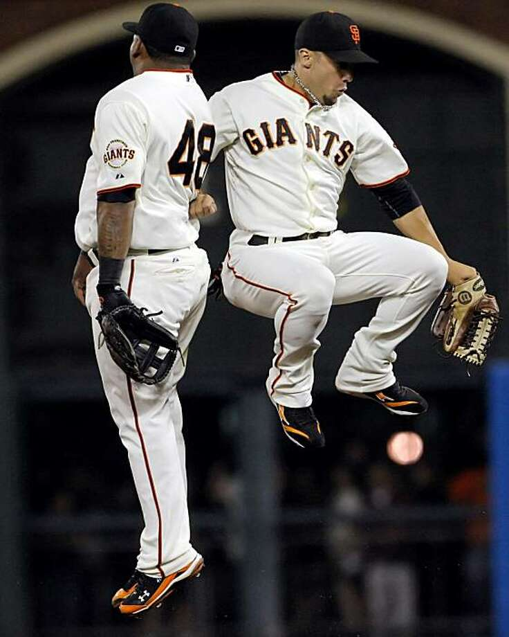 Pablo Sandoval, left, and Andres Torres celebrate after the Giants beat the Mets at AT&T Park on Thursday.Pablo Sandoval, left, and Andres Torres, right, celebrate after the Giants one their game against the Mets. The San Francisco Giants played the New York Mets at AT&T Park in San Francisco, Calif., on Thursday, July 15, 2010. The Giants defeated the Mets 2-0.   Ran on: 10-02-2010 Pablo Sandoval (left) and Andres Torres get the celebration off the ground after the Giants defeated the Mets 2-0 in a July game at AT&T Park.   **MANDATORY CREDIT FOR PHOTOG AND SF CHRONICLE/NO SALES/MAGS OUT/TV OUT/INTERNET: AP MEMBER NEWSPAPERS ONLY** Photo: Carlos Avila Gonzalez, The Chronicle