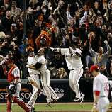 The Giants celebrate with Aubrey Huff at home plate after Juan Uribe's sacrifice fly scored Huff to win the game. The San Francisco Giants played the Philadelphia Phillies at AT&T Park in San Francisco, Calif., on Wednesday, October 20, 2010, in Game 4 ofThe Giants celebrate with Aubrey Huff at home plate after Juan Uribe's sacrifice fly scored Huff to win the game. The San Francisco Giants played the Philadelphia Phillies at AT&T Park in San Francisco, Calif., on Wednesday, October 20, 2010, in Game 4 of the National League Championship Series. The Giants defeated the Phillies 6-5 on a sacrifice fly by Juan Uribe.    **MANDATORY CREDIT FOR PHOTOG AND SF CHRONICLE/NO SALES/MAGS OUT/TV OUT/INTERNET: AP MEMBER NEWSPAPERS ONLY**