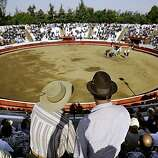 """BULLFIGHTSF-C-19OCT02-LV-CG --- Spectators file into the bull ring in Thornton Ca., on Saturday, October 19, 2002, in preparation for the bullfights to celebrate the """"Lady of Fatima,"""" Festa. The Portugese community of the California Central Valley has kept the tradition of the Bullfights alive as part of the Portugese Festa religious festivals.  Matadors from all over the world participate in the bullfights that range from as far as Fresno to Sacramento. (PHOTO BY CARLOS AVILA GONZALEZ/THE SAN FRANCISCO CHRONICLE)   CAT  NORTHERN CALIF. MANDATORY CREDIT:  PHOTOG AND SAN FRANCISCO CHRONICLE. MAGS OUT, NO SALES"""