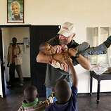 Dr. Frank Artress greets several young orphans at Rift Valley Childrens Village in Karatu, Tanzania on Sunday, October 28, 2007. Artress provides to the orphanage where up to 40 children live in a family-like environment. Dr. Frank Artress, a former cardiDr. Frank Artress greets several young orphans at Rift Valley Childrens Village in Karatu, Tanzania on Sunday, October 28, 2007. Artress provides to the orphanage where up to 40 children live in a family-like environment. Dr. Frank Artress, a former cardiac anesthesiologist from Modesto, Calif., survived a nearly fatal climb on Mount Kilimanjaro nearly five years ago. Since then, he and his wife Susan have returned to Tanzania to heal the people of the country they grew to love and call home. Their work is done for free, through a charitable organization Frank and Susan founded. Photo by Carlos Avila Gonzalez / San Francisco Chronicle   MANDATORY CREDIT FOR PHOTOG AND SAN FRANCISCO CHRONICLE/NO SALES-MAGS OUT