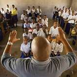 Amiri TK, with Mwangaza, a non-profit dedicated to health related projects for the disabled in Africa, directs children at Three Hills School in Mdori, Tanzania, to be treated by Dr. Frank Artress. Over 450 students will be examined and treated by ArtressAmiri TK, with Mwangaza, a non-profit dedicated to health related projects for the disabled in Africa, directs children at Three Hills School in Mdori, Tanzania, to be treated by Dr. Frank Artress. Over 450 students will be examined and treated by Artress in a three-day period. Dr. Frank Artress, a former cardiac anesthesiologist from Modesto, Calif., survived a nearly fatal climb on Mount Kilimanjaro nearly five years ago. Since then, he and his wife Susan have returned to Tanzania to heal the people of the country they grew to love and call home. Their work is done for free, through a charitable organization Frank and Susan founded. Photo by Carlos Avila Gonzalez / San Francisco Chronicle   MANDATORY CREDIT FOR PHOTOG AND SAN FRANCISCO CHRONICLE/NO SALES-MAGS OUT