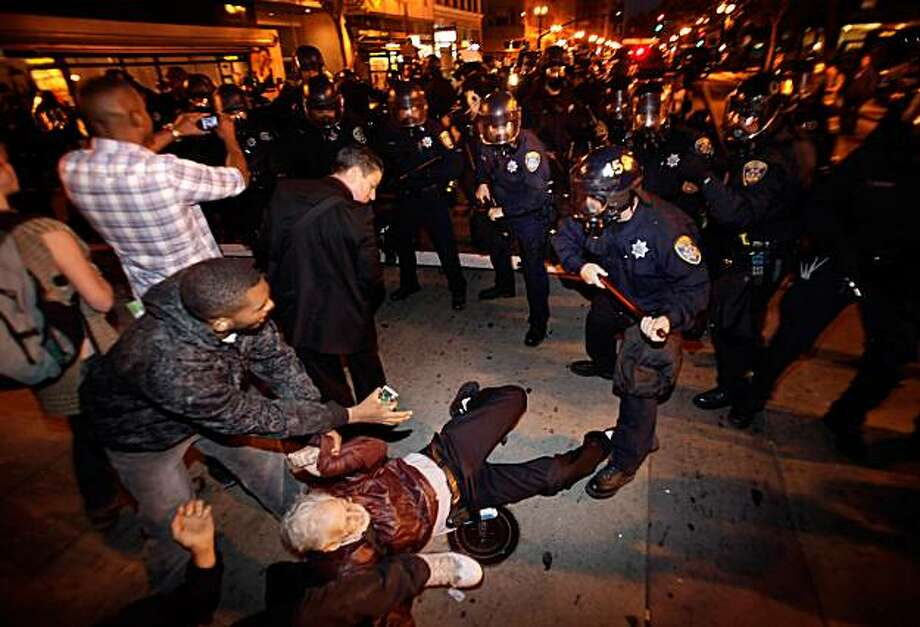 A group of protesters is knocked down as the line of riot police begins to make arrests at the intersection of 14th Street and Broadway. Reaction after the verdict in the Johannes Mehserle trial is announced on Thursday, July 8, 2010. Mehserle was convicA group of protesters is knocked down as the line of riot police begins to make arrests at the intersection of 14th Street and Broadway. Reaction after the verdict in the Johannes Mehserle trial is announced on Thursday, July 8, 2010. Mehserle was convicted of involuntary manslaughter in the shooting of Oscar Grant at the Fruitvale BART station on January 1, 2009.   Ran on: 07-09-2010 Protesters are knocked down as the line of riot police moves in and begins to make arrests at the intersection of 14th Street and Broadway in Oakland. Ran on: 07-09-2010 Protesters are knocked down as the line of riot police moves in and begins to make arrests at the intersection of 14th Street and Broadway in Oakland.   **MANDATORY CREDIT FOR PHOTOG AND SF CHRONICLE/NO SALES/MAGS OUT/TV OUT/INTERNET: AP MEMBER NEWSPAPERS ONLY** Photo: Carlos Avila Gonzalez, The Chronicle