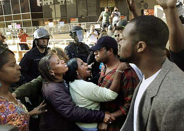 Several women try to maintain the peace at a brief upswell of protesters on 12th Street as police lined up to control the situation. Reaction after the verdict in the Johannes Mehserle trial is announced on Thursday, July 8, 2010. Mehserle was convictedSeveral women try to maintain the peace at a brief upswell of protesters on 12th Street as police lined up to control the situation. Reaction after the verdict in the Johannes Mehserle trial is announced on Thursday, July 8, 2010. Mehserle was convicted of involuntary manslaughter in the shooting of Oscar Grant at the Fruitvale BART station on January 1, 2009.   Ran on: 07-09-2010 Several women try to maintain the peace at 12th Street in Oakland when protesters briefly started to get out of hand, though police quickly lined up to control the situation.   **MANDATORY CREDIT FOR PHOTOG AND SF CHRONICLE/NO SALES/MAGS OUT/TV OUT/INTERNET: AP MEMBER NEWSPAPERS ONLY** Photo: Carlos Avila Gonzalez, The Chronicle