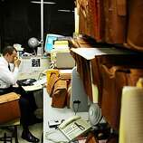 OAKMURDER_001_CAG.JPG 2:28 a.m. October 10, 2003.  Detective Brian Medeiros rubs his eyes as he speaks to a witness by phone from the Homicide Squad Room.  The open files of murders from the past sit all around his desk as a reminder of the heavy task he and his partner have ahead of them. Oakland PD Detectives Brian Medeiros and Phil Green are two of 10 men solving murders in Oakland, which has one of the highest homicide rates in California. Last year the murder rate drew national attention, when more than 100 people died in Oakland - it's highest rate since 1996. This year, though the murder rate is almost identical, the media have moved on to other stories, as Medeiros and Green quietly go about the business of tracking down killers. Photo taken on 10/02/03, in OAKLAND, CA  Photo by Carlos Avila Gonzalez / The San Francisco Chronicle  MANDATORY CREDIT FOR PHOTOG AND SF CHRONICLE/NO SALES-MAGS OUT  Above: Detective Phil Green of the Oakland police department pins up the latest murder tally number  --  at the time, 97  --  on a corkboard in the squad room.   At left: Detective Brian Medeiros inspects the body of a man who was killed in West Oakland earlier that morning. Medeiros and Green are two of 10 men attempting to solve all of the murders in Oakland, a numbers game that makes them the busiest homicide investigators in the state. Lt. Jim Emery says his detectives handle &quo;two to three times'' as many murder cases as most of their counterparts in other cities.     Above: Detective Phil Green of the Oakland police department pins up the latest murder tally number  --  at the time, 97  --  on a corkboard in the squad room.   At left: Detective Brian Medeiros inspects the body of a man who was killed in West Oakland earlier that morning. Medeiros and Green are two of 10 men attempting to solve all of the murders in Oakland, a numbers game that makes them the busiest homicide investigators in the state. Lt. Jim Emery says his detectives handle &quo;tw   Metro#