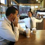 OAKMURDER_007_CAG.JPG 7:57 a.m., November 6, 2003.  Brian Medeiros, rear, stretches and stifles a yawn at a coffee shop in downtown Oakland, Ca., after he and his partner, Phil Green, rubbing his eyes, get a cup of coffee to shake off the effects of an all night murder investigation.  In a few minutes, both will have to go back to the Homicide squad room to finish reports on the murder. Oakland Detectives Brian Medeiros and Phil Green are two of 10 men solving murders in Oakland, which has one of the highest homicide rates in California. Last year the murder rate drew national attention, when more than 100 people died in Oakland - it's highest rate since 1996. This year, though the murder rate is almost identical, the media have moved on to other stories, as Medeiros and Green quietly go about the business of tracking down killers. Photo taken on 11/06/03, in OAKLAND, CA  Photo by Carlos Avila Gonzalez / The San Francisco Chronicle  MANDATORY CREDIT FOR PHOTOG AND SF CHRONICLE/NO SALES-MAGS OUT  Above: Detective Phil Green of the Oakland police department pins up the latest murder tally number  --  at the time, 97  --  on a corkboard in the squad room.   At left: Detective Brian Medeiros inspects the body of a man who was killed in West Oakland earlier that morning. Medeiros and Green are two of 10 men attempting to solve all of the murders in Oakland, a numbers game that makes them the busiest homicide investigators in the state. Lt. Jim Emery says his detectives handle &quo;two to three times'' as many murder cases as most of their counterparts in other cities.     Above: Detective Phil Green of the Oakland police department pins up the latest murder tally number  --  at the time, 97  --  on a corkboard in the squad room.   At left: Detective Brian Medeiros inspects the body of a man who was killed in West Oakland earlier that morning. Medeiros and Green are two of 10 men attempting to solve all of the murders in Oakland, a numbers game that makes them t   Metro#
