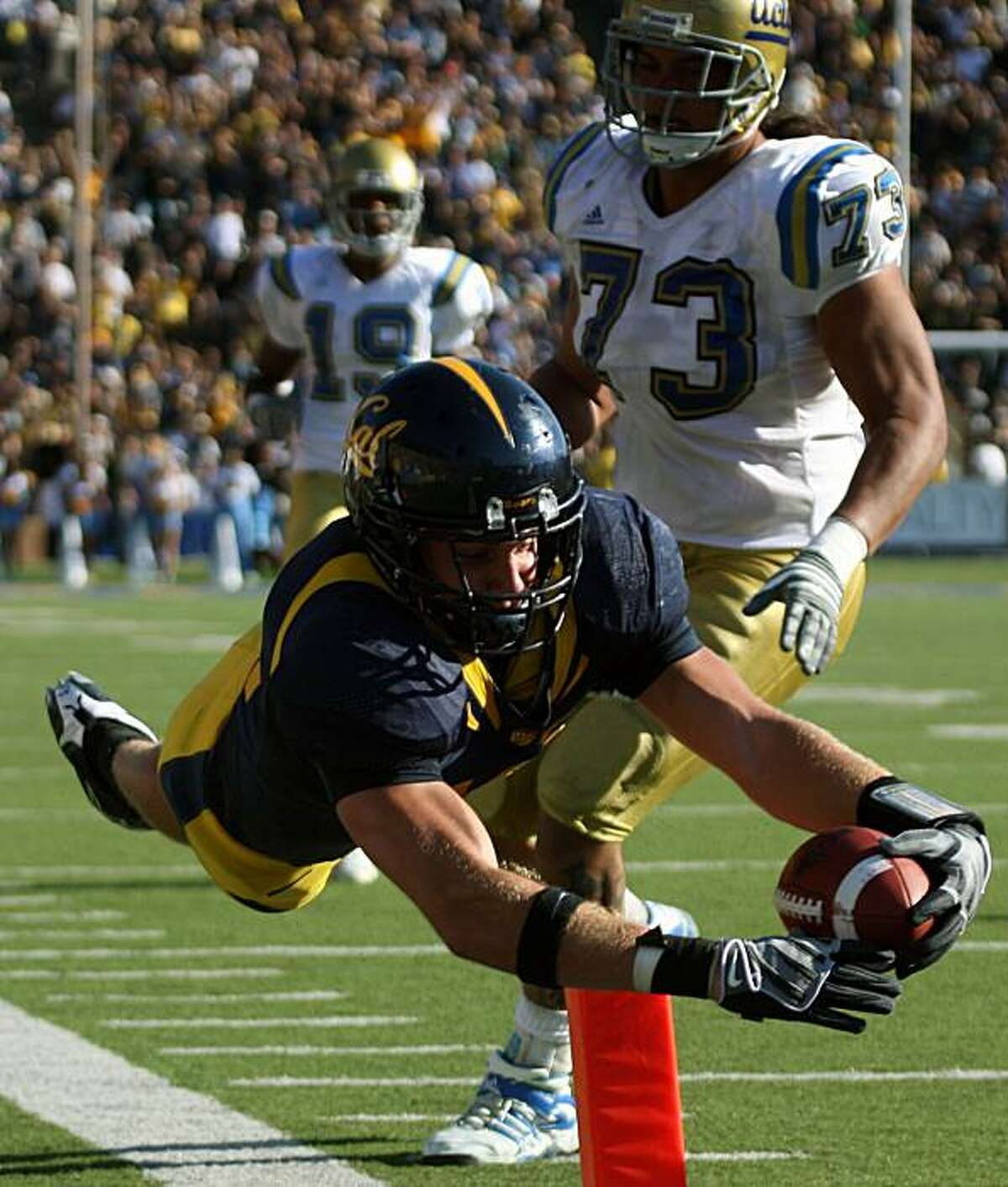California linebacker Michael Mohamed dives into the end zone after intercepting UCLA pass from Kevin Craft in 4th quarter action. Cal defeated UCLA 41-20 in Berkeley Calif. By Lance Iversen