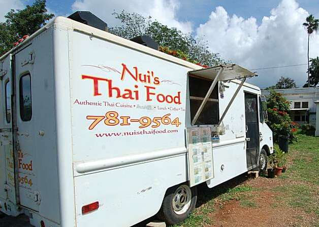 Nui's Thai Food truck has a verdant backdrop in Waialua on Oahu's North Shore. Photo: Jeanne Cooper, Special To SFGate