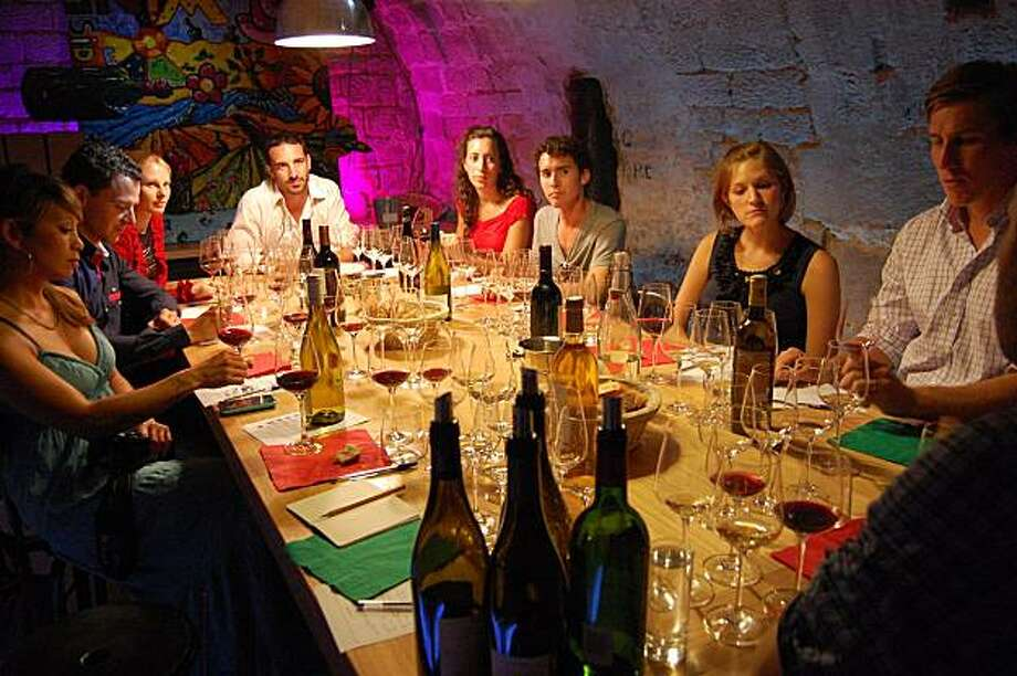 Taking a wine-tasting class — like this one in Paris — helps make French wine less intimidating. Photo: Rick Steves