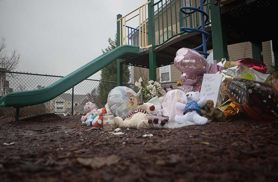 A makeshift memorial sits on the playground where 7-year-old Jorelys Rivera was last seen alive Wednesday, Dec. 7, 2011 in Canton, Ga. Authorities say they have charged 20-year-old Ryan Brunn of Canton with murder in the beating death of Rivera, who was abducted and killed at an apartment complex and her body left in a trash bin. (AP Photo/David Goldman) Photo: David Goldman, AP