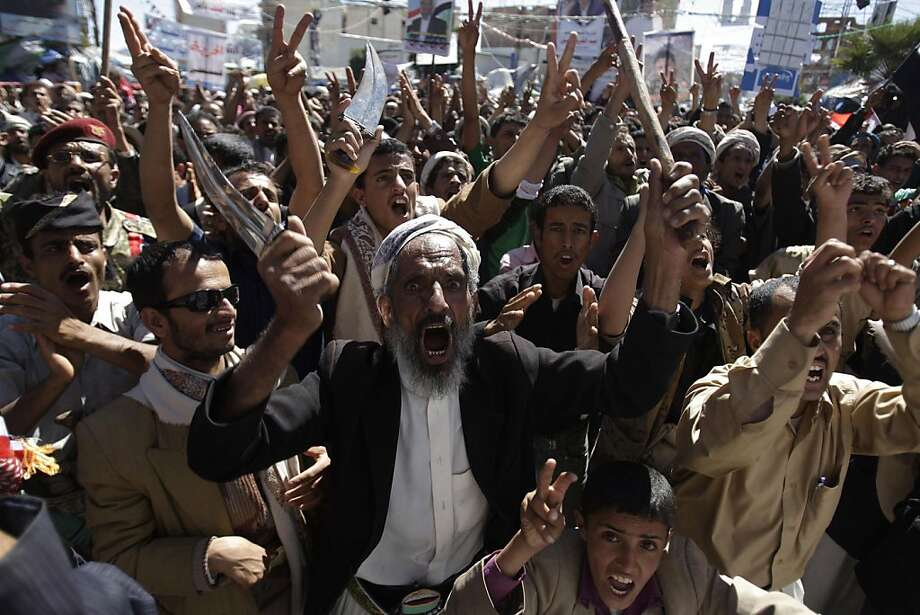 A Yemeni protestor holds a dagger and chants slogans during a demonstration demanding the prosecution of Yemen's President Ali Abdullah Saleh in Sanaa, Yemen, Tuesday, Dec. 6, 2011. (AP Photo/Hani Mohammed) Ran on: 12-08-2011 A Yemeni protester waves a dagger during a demonstration in Sanaa on Tuesday demanding the prosecution of embattled President Ali Abdullah Saleh, a day before a new Cabinet was named to ease him out of office. Photo: Hani Mohammed, AP