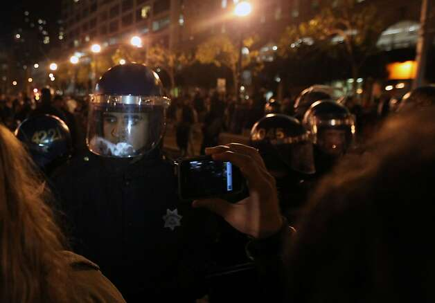 San Francisco police officers face off with approximately 100 protesters who are occupying their former camp, at Justin Herman Plaza in San Francisco, Ca Wednesday December 7, 2011 Photo: Lance Iversen, The Chronicle