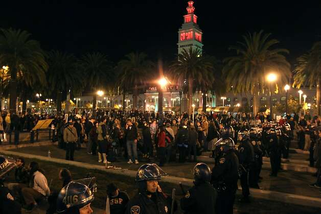 San Francisco police officers surround approximately 100 protesters who are occupying their former camp, at Justin Herman Plaza in San Francisco, Ca Wednesday December 7, 2011 Photo: Lance Iversen, The Chronicle