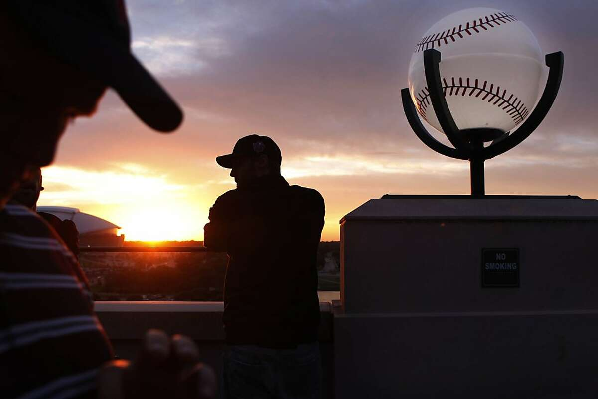 Nick Tanza of San Francisco, who works in the Giants' enterprises department, takes in the view from the top of Rangers Ballpark before Game 5 of the World Series on Monday.