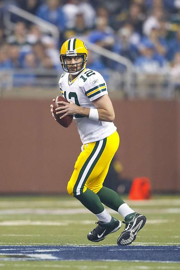 Green Bay Packers quarterback Aaron Rodgers (12) drops back to pass in the fourth quarter of an NFL football game against the Detroit Lions in Detroit, Thursday, Nov. 24, 2011. (AP Photo/Rick Osentoski)  Ran on: 12-08-2011 Green Bay's Aaron Rodgers has completed at least 27 passes to five different players this season. Ran on: 12-08-2011 Green Bay's Aaron Rodgers has completed at least 27 passes to five different players this season. Ran on: 12-08-2011 Green Bay's Aaron Rodgers has completed at least 27 passes to five different players this season. Photo: Rick Osentoski, AP