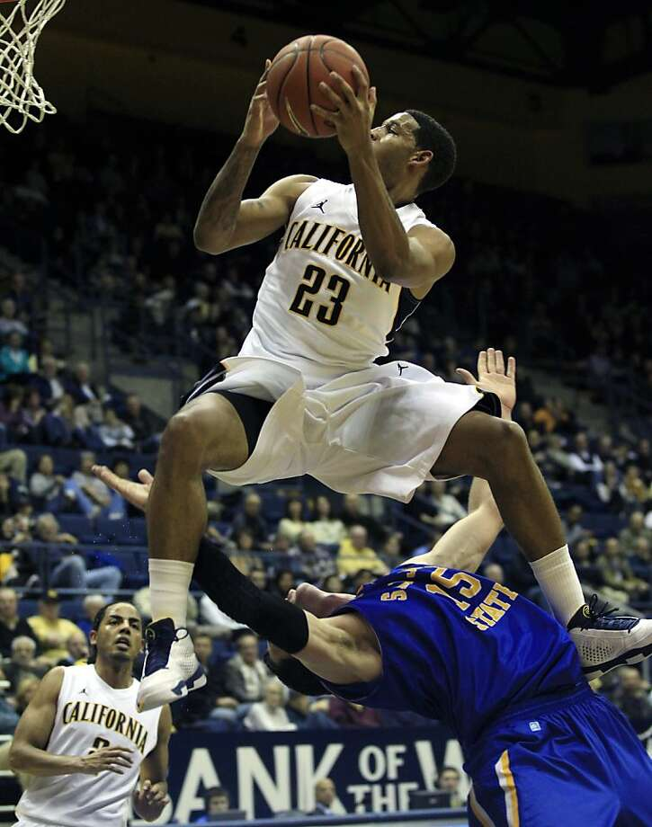 California's Allen Crabbe (23) is fouled by San Jose State 's Wil Carter (15) on his way to the basket during the first half of an NCAA college basketball game in Berkeley, Calif., Wednesday, Dec. 7, 2011. (AP Photo/Marcio Jose Sanchez)  Ran on: 12-08-2011 Allen Crabbe gets fouled by San Jose State's Wil Carter. Crabbe had a game-high 18 points. Photo: Marcio Jose Sanchez, AP