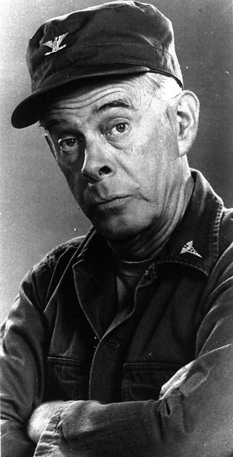 """FILE - In this 1976 handout photo, Harry Morgan poses on the set of his television show """"MASH,""""   The Emmy-winning character actor whose portrayal of the fatherly Col. Potter on television's """"M*A*S*H"""" highlighted a show business career that included nine other TV series, 50 films and the Broadway stage, died Wednesday, Dec. 7, 2011. He was 96.  Morgan appeared in mostly supporting roles on the big screen, playing opposite such stars as Henry Fonda, John Wayne, James Garner, Elvis Presley and Dan Aykroyd. On television, he was more the comedic co-star, including roles on """"December Bride,"""" its spin-off """"Pete and Gladys,"""" as Sgt. Joe Friday's loyal partner in later """"Dragnet"""" episodes and on CBS-TV's long-running """"M-A-S-H"""" series, for which he earned an Emmy award in 1980.  (AP Photo) Photo: Cbs, AP"""