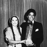 American pop singers Nicolette Larson (1952 - 1997) and Michael Jackson (1958 - 2009) present the award for Favorite Pop/Rock Band, Duo, or Group at the American Music Awards, January 1980. The award went to the Bee Gees..