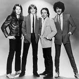 Hard rock band Thin Lizzy, circa 1980. From left: Guitarists Scott Gorham and Snowy White, drummer Brian Downey and singer/bassist Phil Lynott (1949 - 1986)..