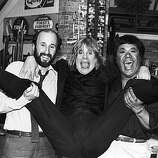 Heavy metal singer Ozzy Osbourne spreads his legs as he is held by MTV executive producer Julian Goldberg (left) and MTV VJ J.J. Jackson, circa 1982. Osbourne announced that he would establish a scholarship fund in the name of guitarist Randy Rhoads..