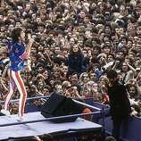 1982: Mick Jagger, the lead singer of The Rolling Stones, performing at Wembley Stadium..