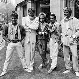 British pop group Duran Duran smile and laugh while posing on a lawn, England, c. 1983. From left: Brothers Roger and John Taylor, Nick Rhodes, Andy Taylor (unrelated) and Simon Le Bon..