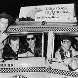 English punk band The Clash in a New York taxicab, 1983. Left to right: Paul Simonon, Pete Howard, Joe Strummer (1952 - 2002) and Mick Jones. (Photo by Dave Hogan/Hulton Archive/Getty Images)