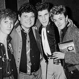 Members of American rock & roll group the Stray Cats with Don Everly after the Everly Brothers reunion concert at the Royal Albert Hall, London, 23rd September 1983. Left to right: Lee Rocker, Don Everly, Slim Jim Phantom, Brian Setzer..