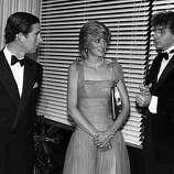 6th October 1983: American singer and songwriter Barry Manilow, right, talking to Diana, Princess of Wales (1961 - 1997) and Charles, Prince of Wales, backstage at the Royal Festival Hall, London..