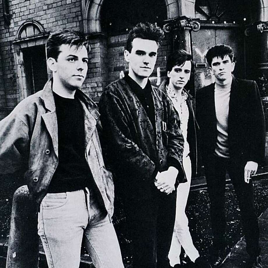 "The Smiths, from left, bassist Andy Rourke, singer Morrissey, guitarist Johnny Marr, drummer Mike Joyce. The group allowed PETA to use their hit song ""Meat is Murder"" to be used in an animal rights-themed video game. Photo: Warner Bros."