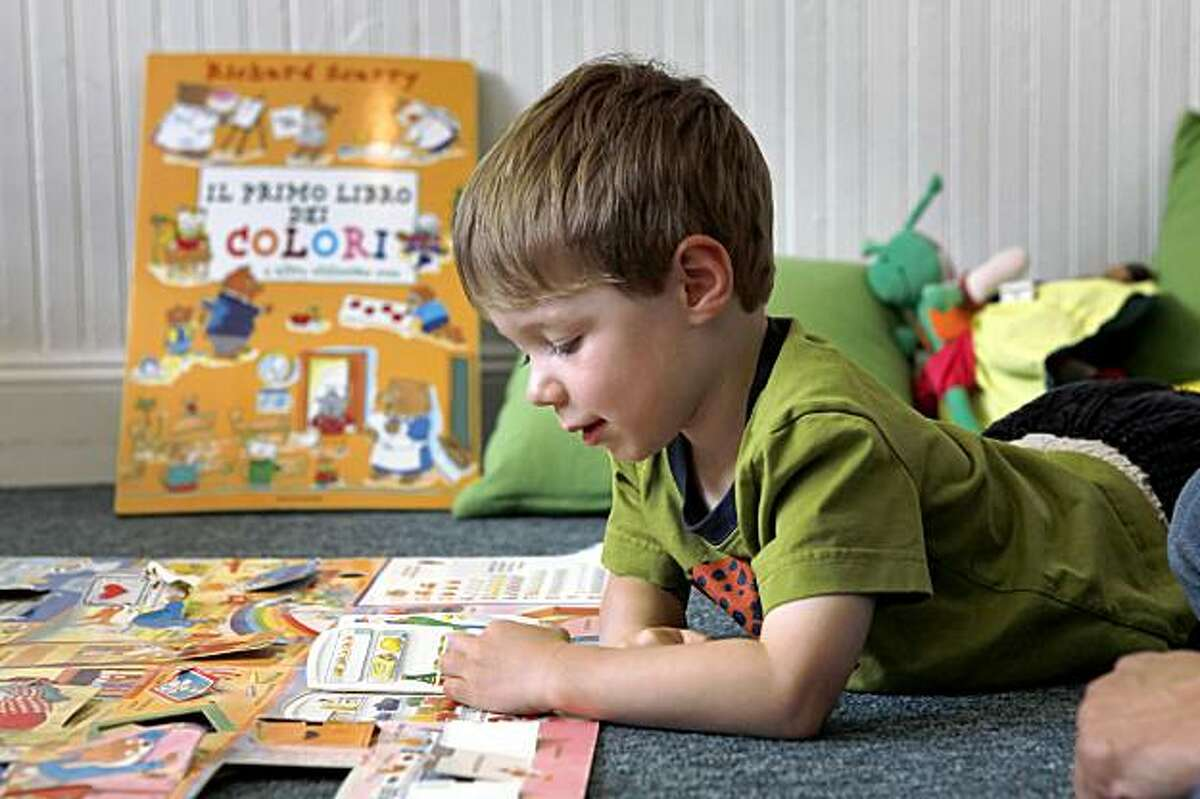 Gianluca Carboni, 3, reads from italian preschool books at Spazio Italiano, in San Francisco, Calif., on Wednesday, June 3, 2009. Interest in italian preschools & italian education is exploding in the bay area, more so than anywhere else in the country. the 2 biggest preschools started 5 yrs ago. One of these schools is