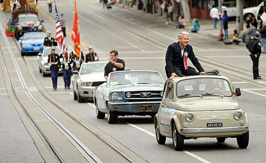 Fabrizio Marcelli, Consul General of Italy, rides atop a Fiat during the 141st Annual Italian Heritage Parade on Sunday, Oct. 11, 2009, in San Francisco. Photo: Noah Berger, Special To The Chronicle