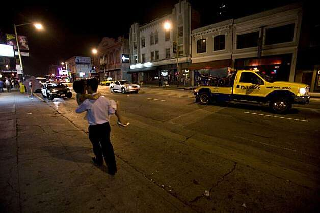 "Clubbers travel on Broadway near Kearny Street in San Francisco, Calif., on Saturday, Aug. 2, 2008. Officials are cracking down on street activity outside clubs on Broadway near Columbus. ""Club 443"" , across the street was ordered not to open on this night. Photo: Kim Komenich, The Chronicle"