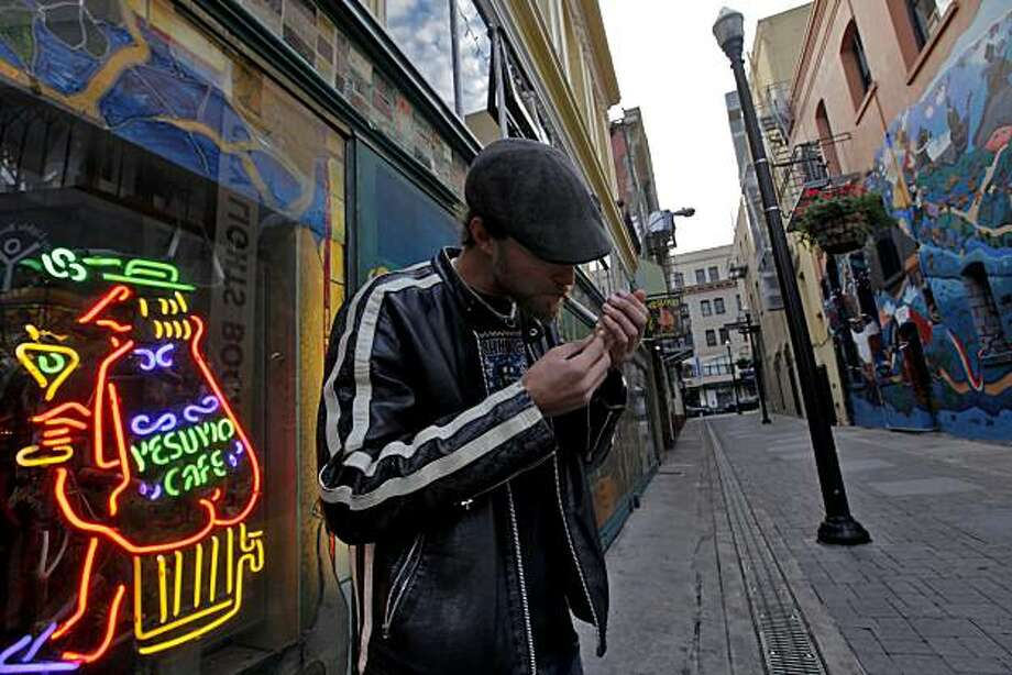 James McClurg, 25 years old, enjoys a smoke outside the Vesuvio Cafe in kerouac alley, Wednesday Dec. 1, 2010, in San Francisco, Calif. Photo: Lacy Atkins, The Chronicle
