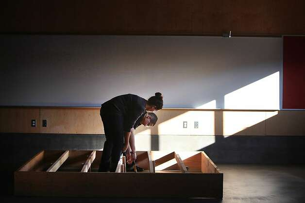 John O'Connell High School advanced carpentry students Lucerito Martinez, 16,  and Sergio Navarro, 17, work together to rough frame a stage being built in the new industrial arts building at John O'Connell High School on  Wednesday, December 7, 2011 in San Francisco, Calif.  The stage was being built for a ceremony for the new building to be held the next day. Ran on: 12-08-2011 Students Lucerito Martinez, 16, and Sergio Navarro, 17, help build a stage at O'Connell High. Ran on: 12-08-2011 Students Lucerito Martinez, 16, and Sergio Navarro, 17, help build a stage at O'Connell High. Ran on: 12-08-2011 Students Lucerito Martinez, 16, and Sergio Navarro, 17, help build a stage at O'Connell High. Photo: Lea Suzuki, The Chronicle