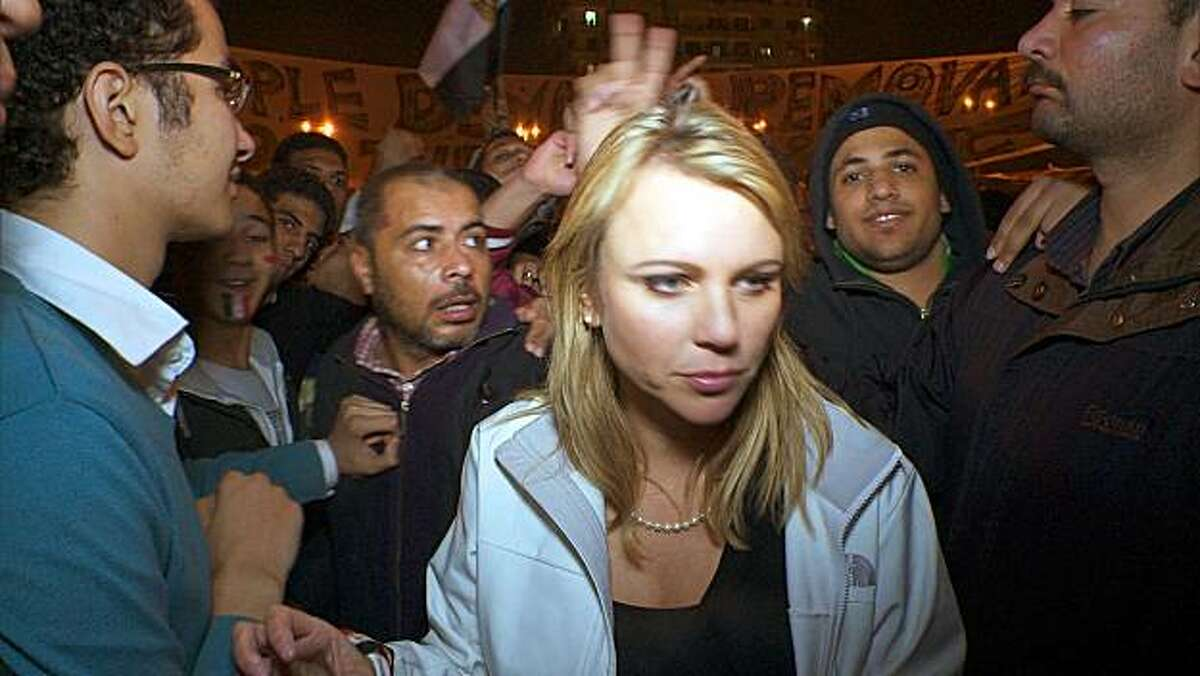 """In this Feb. 11, 2011 photo released by CBS, """"60 Minutes"""" correspondent Lara Logan is shown covering the reaction in in Cairo's Tahrir Square the day Egyptian President Hosni Mubarak stepped down. CBS News says Logan was attacked Friday, and suffered a brutal beating and sexual assault before being saved by a group of women and an estimated 20 Egyptian soldiers. She is recovering in a U.S. hospital. Logan, CBS News' chief foreign affairs correspondent, is one of at least 140 correspondents who have beeninjured or killed since Jan. 30 while covering the unrest in Egypt, according to the Committee to Protect Journalists."""