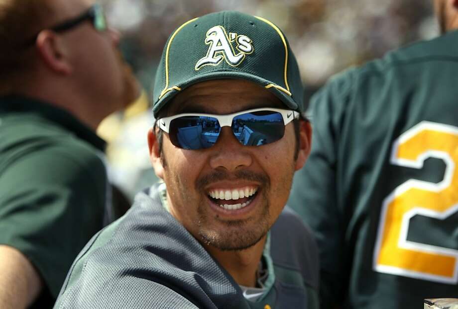 Catcher Kurt Suzuki enjoys a day off during the A's spring training game against the Chicago White Sox at Phoenix Municipal Stadium in Phoenix on Saturday. Photo: Paul Chinn, The Chronicle