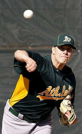Andrew Bailey threw from the mound. The Oakland Athletics held their second workout of the spring mostly for pitchers and catchers Thursday February 17, 2011 at Phoenix Stadium. Photo: Brant Ward, The Chronicle