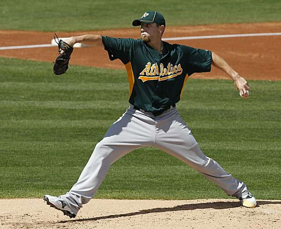 Oakland Athletics starting pitcher Dallas Braden throws to the Cleveland Indians during the second inning of a spring training baseball game in Goodyear, Ariz., Monday, March 14, 2011. Photo: Chris Carlson, AP