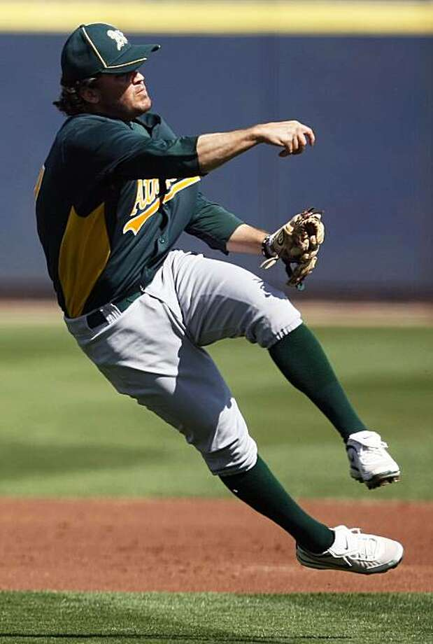Oakland Athletics second baseman Wes Timmons throws a Milwaukee Brewer out at first base during the first inning of their spring training baseball game at Maryvale Baseball Park in Phoenix, Ariz. Thursday, March 3, 2011. Photo: Lance Iversen, The Chronicle
