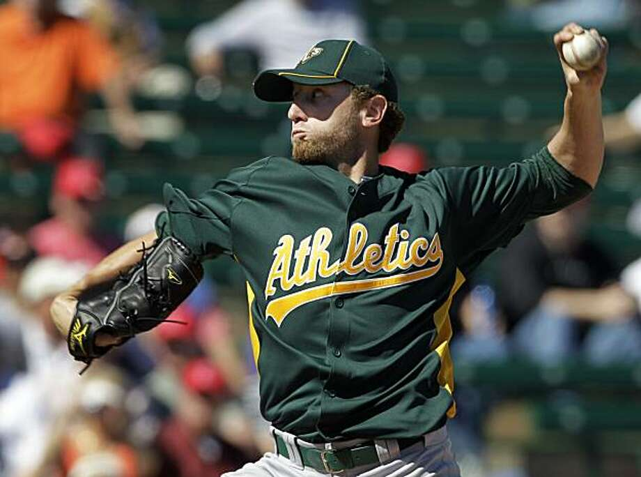 Oakland Athletics' Dallas Braden pitches against the Los Angeles Angels in the first inning of a spring training baseball game Monday, Feb. 28, 2011, in Tempe, Ariz. Photo: Mark Duncan, AP