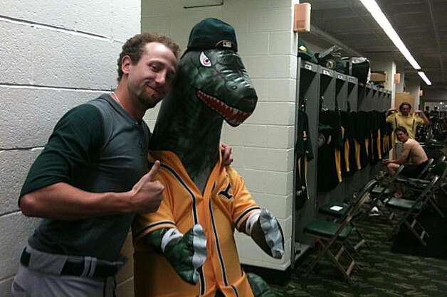 Dallas Braden of the Oakland Athletics with an inflatible godzilla in honor of Hideki Matsui who arrived at A's training camp on Saturday. Matsui's nickname is Godzilla. Photo: Susan Slusser, The Chronicle